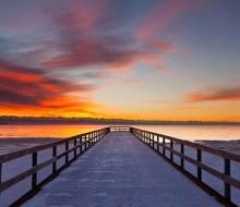 Snow covered sunrise atBlair Street Pier