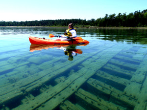 Sue Peterman kayaks over a shipwreck in Bell Bay on Lake Huron.