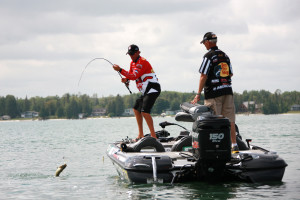 Kevin VanDam pulls in a bass on Long Lake