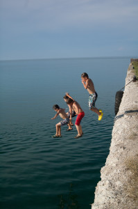 Last year's winning cover photo features kids jumping at Rockport, courtesy Florence Stibitz.