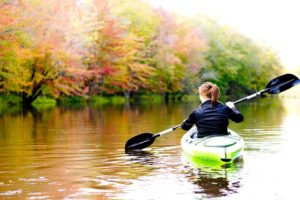 kayaking the river in fall