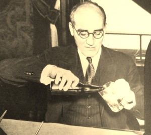 Michigan Governor William A. Comstock pours himself a beer after the ratification of the 21st Amendment!