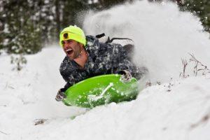 Adam Zeeman has a blast sledding after a winter snowfall. Photo courtesy, Paul Gerow.