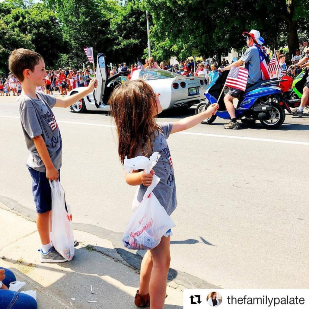 kids waiting for candy at 4th of July Parade. Photo by Holly Sosa.