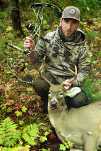 Micah Faunce harvests a healthy buck while bow hunting in the Alpena area, photo courtesy Thomas Faunce.